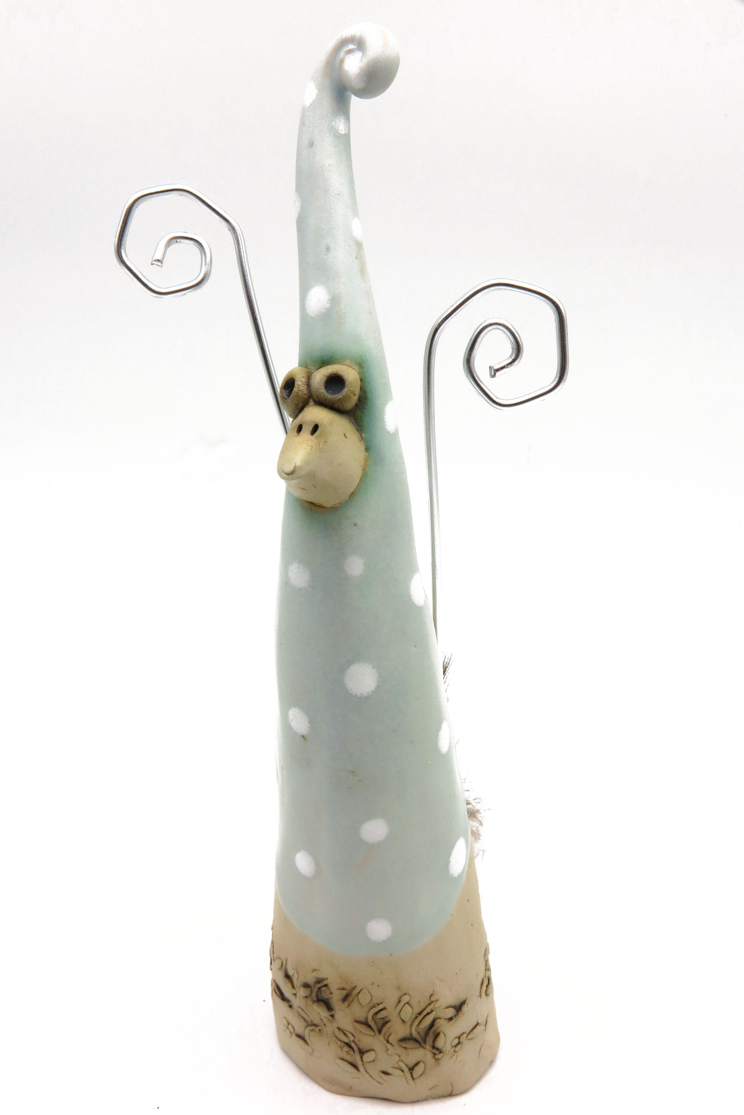 Schräger Vogel pastellmint/L 20 cm